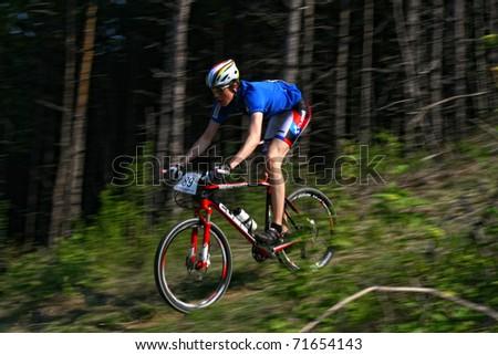"CLUJ-NAPOCA, ROMANIA - APRIL 24: unknown Romanian biker in action at ""Maros Bike Downhill Marathon 2010"" on APRIL 24, 2010 , Cluj-Napoca, Romania - stock photo"