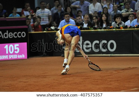 CLUJ-NAPOCA, ROMANIA - APRIL 17, 2016: WTA 6 ranked woman tennis player Simona Halep plays against Angelique Kerber during a Fed Cup Play-Offs Tennis match, Romania vs Germany - stock photo