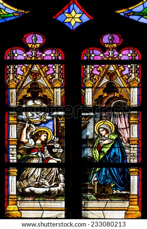 CLUJ NAPOCA, ROMANIA - AUGUST 21, 2014: Biblical Scene Stained Glass Window Inside The Gothic Roman Catholic Church of Saint Michael Built In 1390. - stock photo