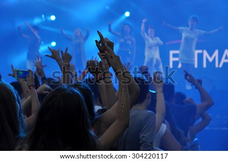 CLUJ NAPOCA, ROMANIA - AUGUST 2, 2015: Crowd of party people having fun during a Fatman Scoop concert at the Untold Festival  - stock photo