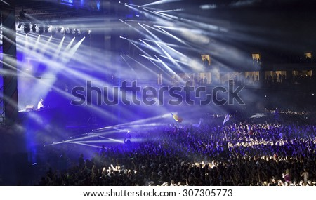 Cluj-Napoca, Romania - August 2, 2015: Crowd of people enjoy David Guetta live concert at the Untold Festival in the European Youth Capital city of Cluj Napoca - stock photo