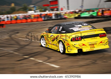 CLUJ NAPOCA, ROMANIA - JUNE 26: An international racer drifts away in a specially designed circuit, at King of Europe event, on June 26, 2010 in Cluj-Napoca, Romania - stock photo