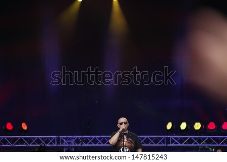 CLUJ NAPOCA, ROMANIA - JUNE 7: The famous romanian rock band Bere Gratis performs on stage during the Cluj Arena Music Fest 2013, on June 7, 2013 in Cluj Napoca, Romania. - stock photo