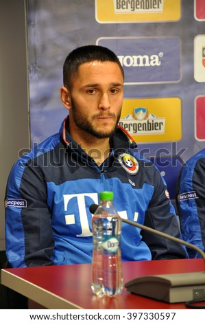 CLUJ-NAPOCA, ROMANIA - MARCH 26, 2016: Player of the Romanian National Football Team, Florin Andone speaks during a press conference before the match against Spain - stock photo