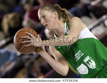 CLUJ-NAPOCA, ROMANIA - MARCH 3: Woman basketball player in action at a Romanian National Championship basketball game U Mobitelco vs LMK Sf. Gheorghe March 3, 2010 in Cluj-Napoca, Romania. - stock photo