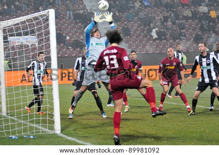 CLUJ-NAPOCA, ROMANIA - NOVEMBER 19: Goalkeeper Marius Popa in action at a Romanian League 1 soccer game CFR Cluj vs. UNIVERSITATEA CLUJ, final score: 3-1, on Nov. 19, 2011 in Cluj-Napoca, Romania. - stock photo