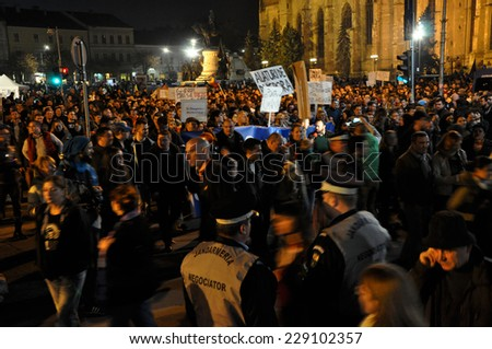 CLUJ, ROMANIA - NOVEMBER 8: Before the second round of Presidential Elections citizens protest against the socialist candidate, Victor Ponta. On Nov 8, 2014 in Cluj, Romania - stock photo