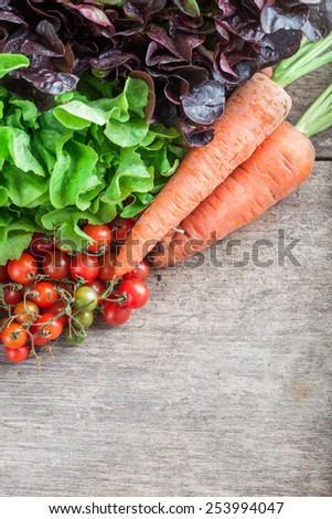 Cluster of cherry tomatoes carrot and vegetable - stock photo