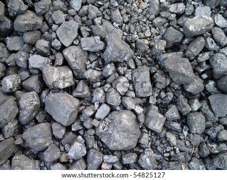 Cluster of pieces Coal used to power an old fashion train.  Pile of coal makes a cool pattern for a background. - stock photo