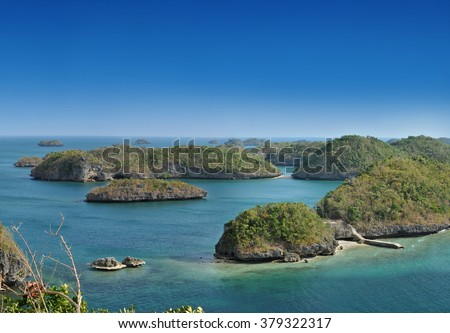 Cluster of small islands in Hundred Islands National Park, Pangasinan, Philippines. - stock photo