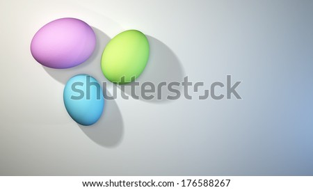 Cluster of three pastel colored Easter eggs on a bright white background - stock photo