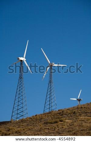 Clusters of wind generators form multi-megawatt wind farms near Tehachapi, California - stock photo