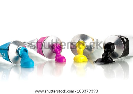 cmyk color, tin tubes squeezed - stock photo