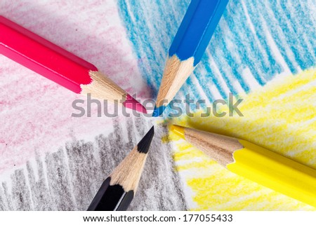 CMYK, colored pencils on paper inflicted colored trail - stock photo