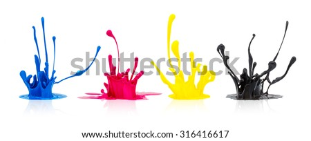 CMYK paint splashing on white background - stock photo