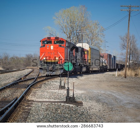 CN red freight train from Detroit Tunnel to Chicago - stock photo