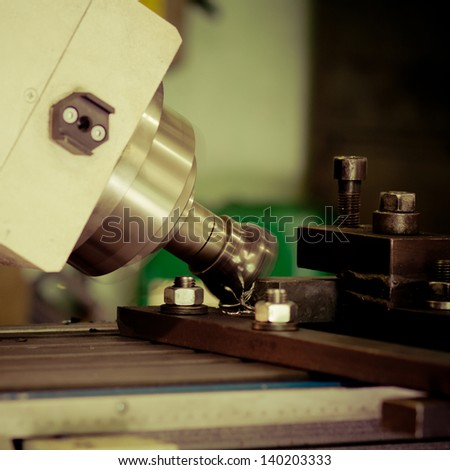 CNC drilling and milling in a workshop - colorized photo - stock photo