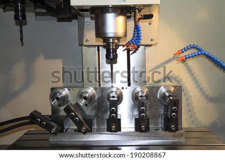 CNC machine at work  - stock photo