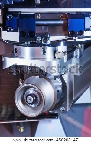 CNC machine tool grinding. The working body of the grinding diamond wheel. - stock photo