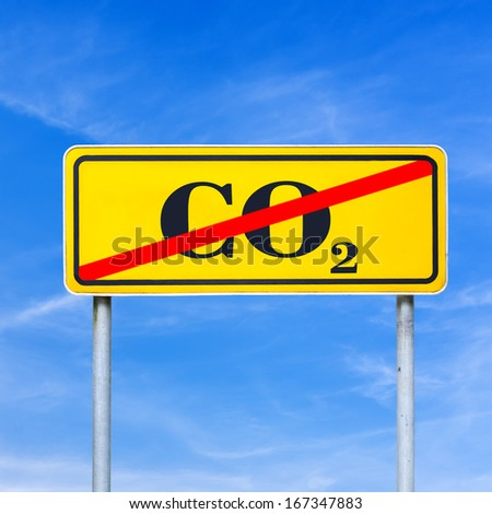 CO2 sign crossed off on a yellow road sign. - stock photo