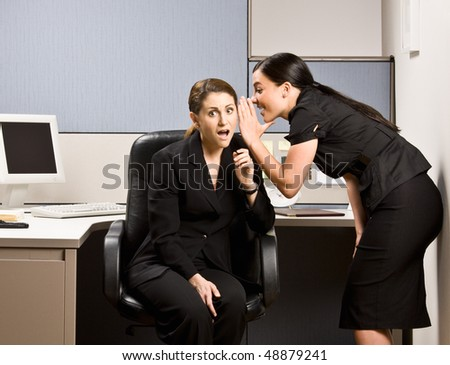 Co-workers gossiping - stock photo