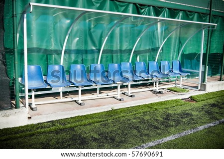 Coach and reserve benches in a soccer field - stock photo