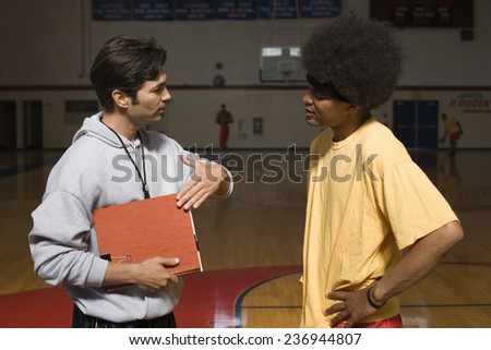 Coach With Player - stock photo