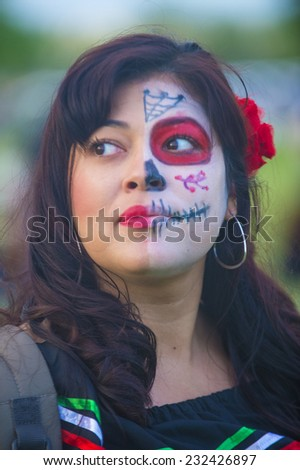 COACHELLA , CALIFORNIA - NOV 01 : A woman with her face painted at the Dia De Los Muertos Experience in Coachella , California on November 01 2014 - stock photo