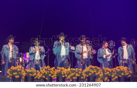 COACHELLA , CALIFORNIA - NOV 01 : Members of the band Banda Machos perform live on stage at the Dia De Los Muertos celebration in Coachella , California on November 01 2014 - stock photo