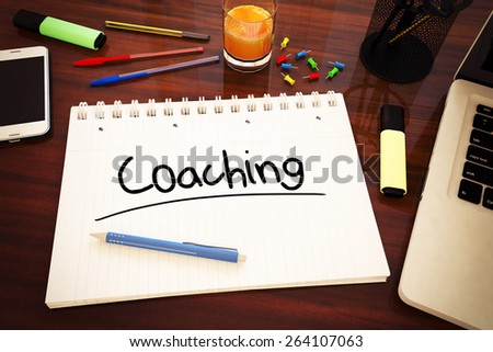 Coaching - handwritten text in a notebook on a desk - 3d render illustration. - stock photo