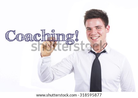Coaching! - Young smiling businessman writing on transparent surface - stock photo