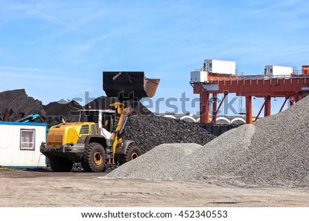 Coal and piles of stones yard storage. - stock photo