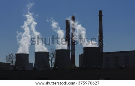 Coal-Burning Power Plant silhouette - stock photo