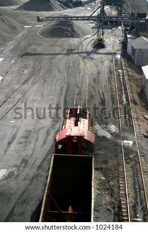 coal car on railroad track - stock photo