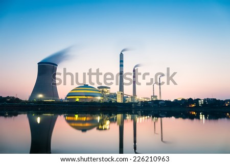 coal-fired power plant in nightfall , industrial landscape   - stock photo