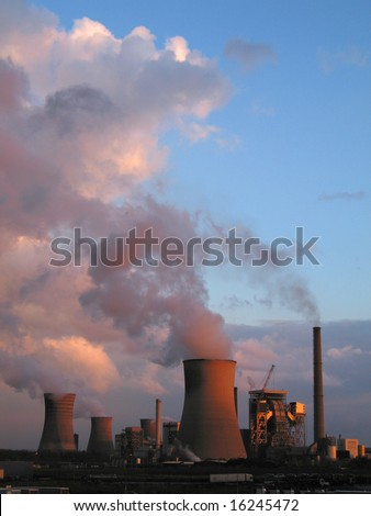 Coal fired power plants generanting smokes at the sunset - stock photo