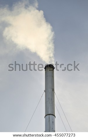 Coal Fossil Fuel Power Plant Smokestacks Emit Carbon Dioxide Pollution - stock photo