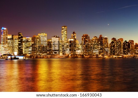 Coal harbor in Vancouver at night - stock photo