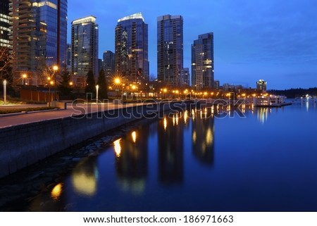 Coal Harbor Towers, Twilight, Vancouver. Condominiums at twilight reflect in the calm water of Coal Harbor in downtown Vancouver. British Columbia, Canada.  - stock photo