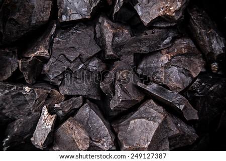 Coal lumps on dark background, close-up - stock photo