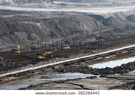 Coal mine with bucket wheel excavator. - stock photo