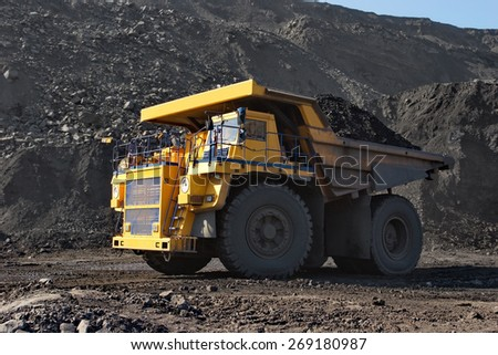 Coal mining. The truck transporting coal. - stock photo