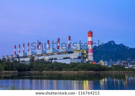 Coal power plant at dusk - stock photo