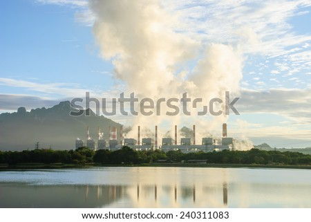 Coal power plant with steam pouring out of the stack, Mae Moh Power Plant, Lampang, Thailand - stock photo