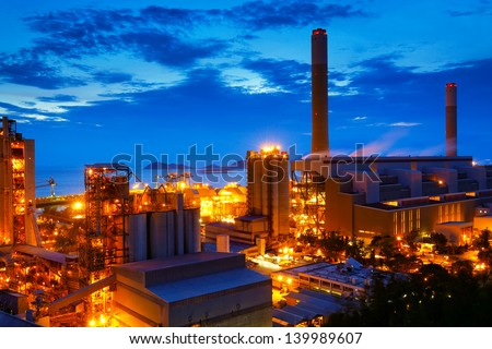 coal power station and cement plant at night - stock photo
