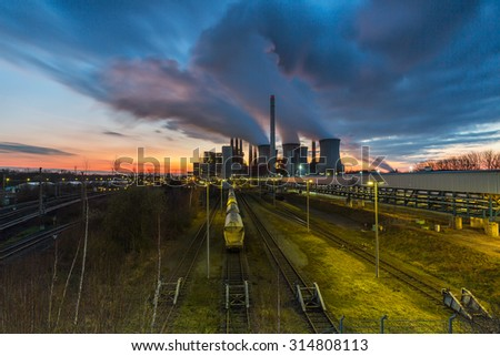 Coal power station with cloudy sunset sky in neurath, germany - stock photo