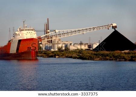 Coal Ship Unloading - stock photo