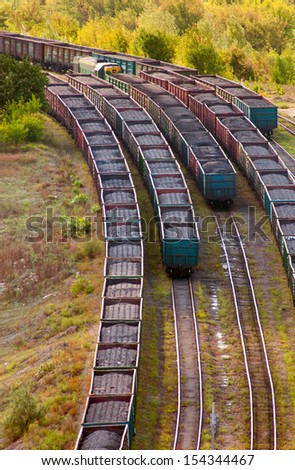 Coal wagons on railway tracks - stock photo