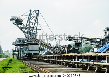 Coal was transported by coveyor belts from open-pit mine to the stock pile, Mae Moh mine, Lampang, Thailand. - stock photo