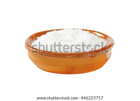Coarse grained salt in terracotta bowl - stock photo